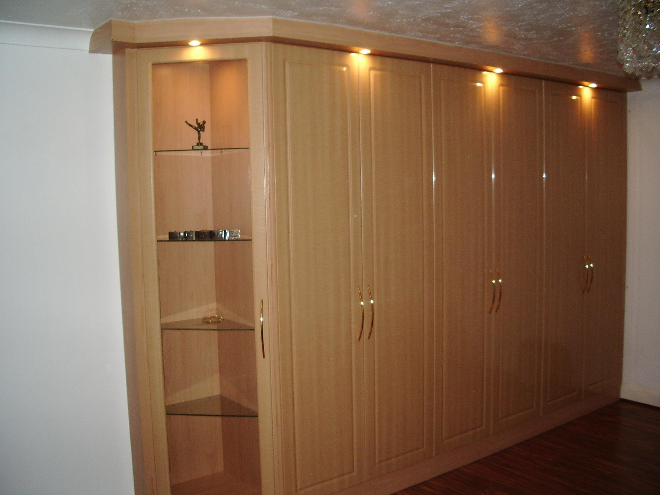 A beautiful example of made to measure wardrobes in a golden maple gloss