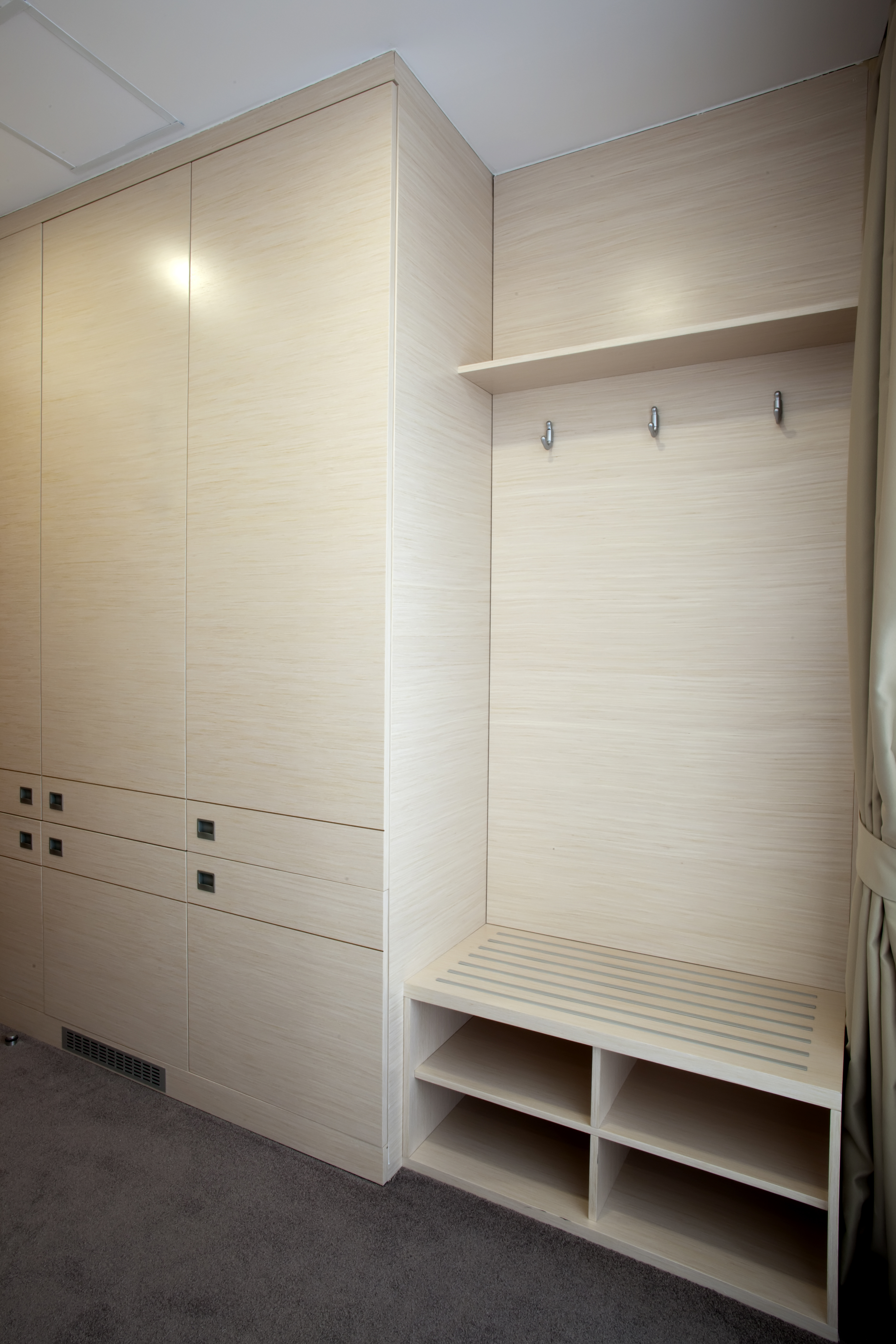 Made to measure fitted wardrobes, shoe storage space and open hanging solution for overall heavy jackets
